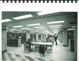 Students studying at tables in the reference section of Main Library, the University of Iowa, 1972