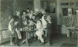 School children preparing food in class, The University of Iowa elementary school, 1920s