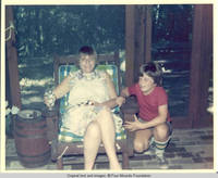 Frindy and John, Jr. sitting in screened in porch