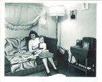 Woman holding child in married student housing, the University of Iowa, fall 1948