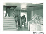 Men moving items into Main Library, the University of Iowa, 1951