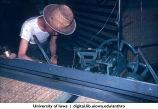 Working on the edge of a tatami mat, Shinkyo commune, Nara-ken, Japan, June 1965