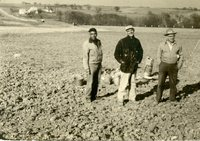 Peterson, Maddy, Moldenhauer standing in uncultivated land, 1959