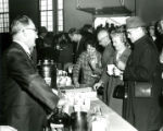 Alumni being served coffee and donuts at Homecoming, 1968