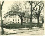 Hall of Liberal Arts with wooden sidewalks and iron fence, The University of Iowa, 1904