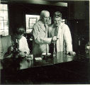 College of Pharmacy Dean Wilbur J. Teeters with students, The University of Iowa, 1940s