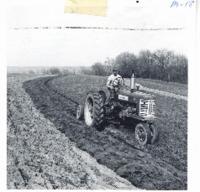 Eldon Sieverding plowing contour strips, 1963
