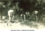 Using different fires and cooking devices at Marjory Camp, The University of Iowa, 1930s
