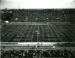 "The ISU Marching Band in """"I"""" formation on the football field at Homecoming, 1974"