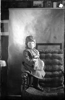 UP611 Child sitting on arm of chair