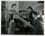 Professor Les Kelso describing the propulsion system of a small airplane to three cadettes, 1943