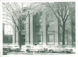 Cars parked on street in front of Trowbridge Hall, The University of Iowa, November 1960