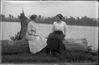 UP610 Ellen Hanson and woman on log by river