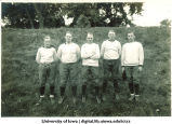 Football players standing on a hill, The University of Iowa, 1900s