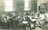 Students writing in classroom, The University of Iowa high school, 1919