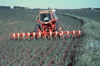 Farmer using a cultivator in Cherokee County, Iowa.