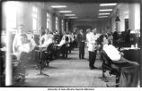 Students in the Dental Clinic, north row, Old Dental Building, The University of Iowa, March 29, 1910