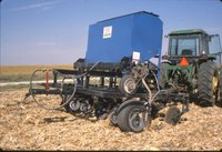 Farm tractor with spraying equipment