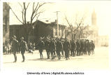 Soldiers marching in formation on Mecca Day, The University of Iowa, 1910s