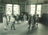 Children standing in circle in playroom, The University of Iowa, 1920s
