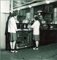 Pharmacy students working in laboratory, The University of Iowa, 1940s