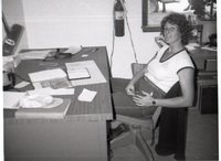 Unidentified Young Woman Sits at Desk