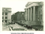 Commencement procession walking south along Old Capitol west portico, The University of Iowa, June 1930