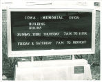 Sign posting hours to Iowa Memorial Union, the University of Iowa, 1960s