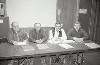 Four Men at a Meeting