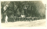 Marching band in parade near Pentacrest, The University of Iowa, 1915