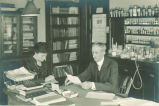 College of Pharmacy Dean Wilbur J. Teeters and secretary in his office, The University of Iowa, 1910s