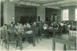 Students reading at tables in the Chemistry library, The University of Iowa, 1930s