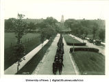 Commencement procession walking west on Iowa Avenue with Pentacrest in background, The University of Iowa, June 1929