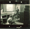 Small boys playing with wood boxes in a playroom, The University of Iowa, January 12, 1938
