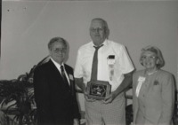 Clint Goos (middle) accepts the Outstanding Soil and Water Conservation District Commissioner Award.