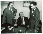 Fred Pownall with a journalism trophy, The University of Iowa, 1950s
