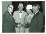 Iowa State Board of Regents president Harry Hagemann with outgoing members Roy Stevens, Mrs. Morris Berkness and Clifford Strawman, June 19, 1959