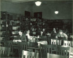 Students studying in a small library, The University of Iowa, March 1930