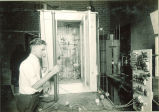 Man conducting an electricity experiment, The University of Iowa, 1930s