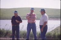 Three men near pond