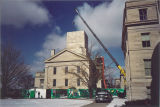 Crane lowering replacement dome onto Old Capitol, The University of Iowa, February 24, 2003