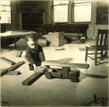 Small boy playing with wood toys and blocks, The University of Iowa, January 12, 1938
