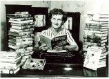 Mildred Wirt Benson in her writing room among her books, Toledo, Ohio, summer 1949