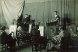 Life model sitting for students at easels, The University of Iowa, 1920s