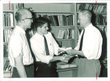Teacher presenting certificate to student, The University of Iowa, 1960s