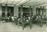 Students reading at tables in the Pharmacy library, The University of Iowa, 1930s