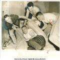 Football player Dick Klein dumped off his mattress by teammates between Rose Bowl practice sessions, Pasadena, Calif., December 22, 1956
