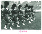 Scottish Highlander bagpipers marching in formation, The University of Iowa, 1960s