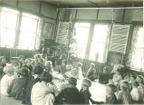 Children gathered around the Christmas tree, The University of Iowa, 1920s