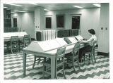 Studying in the reference area of the Main Library, the University of Iowa, July 1956
